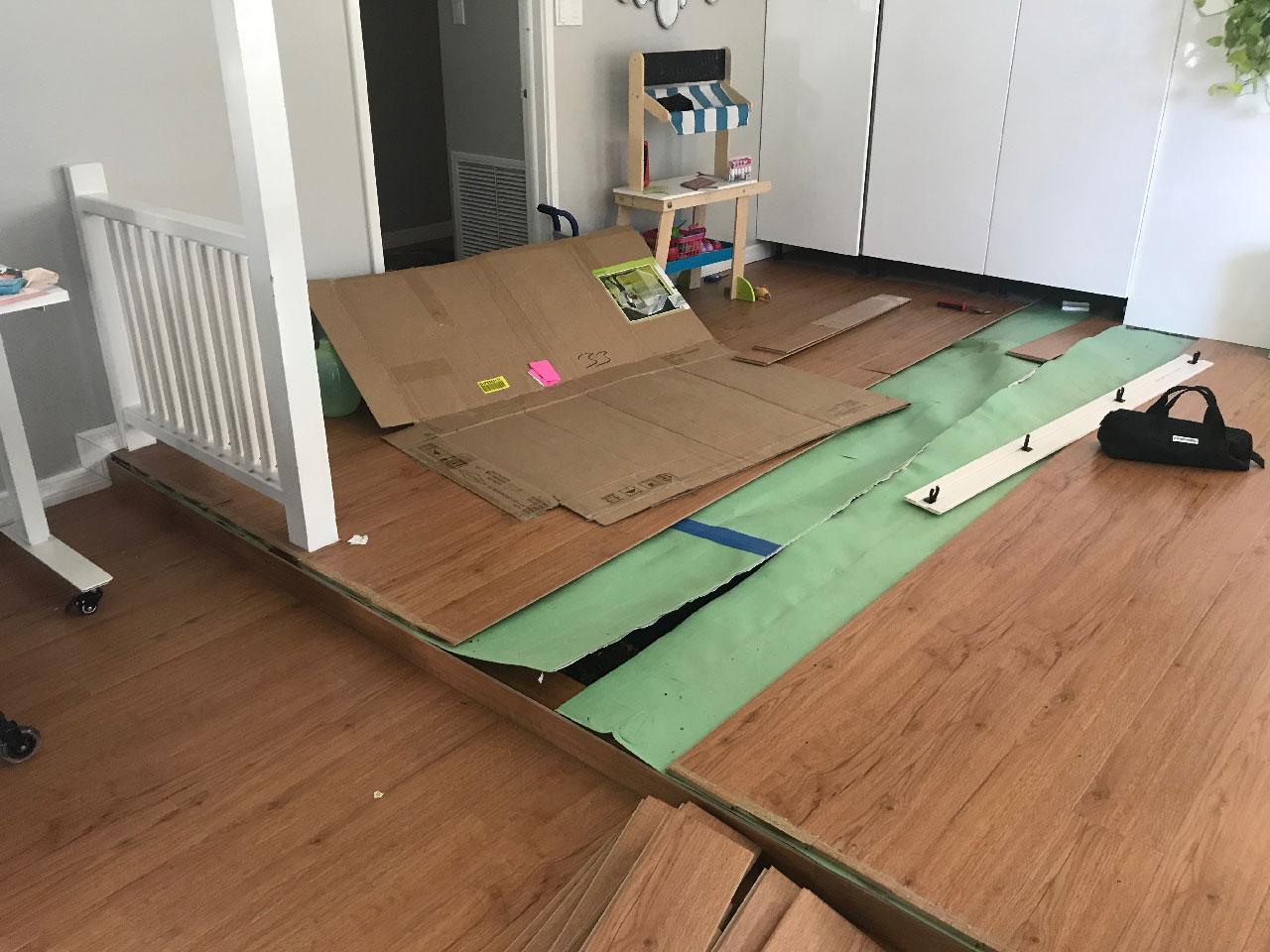 Assessing the living room floor damage